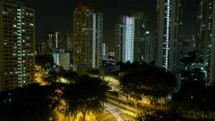 Night Timelapse of Residential Area in a Town with a Busy Road Traffic Junction Stock Footage