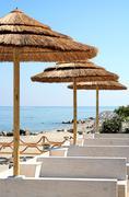 Stock Photo of Resort seating with straw umbrella