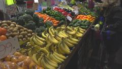 Customer shopping for fruit and vegies at market Stock Footage