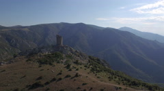 4K AERIAL VIEW OLD TOWER TOP OF MOUNTAIN (360 view) Stock Footage