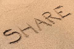 Share Sign On Sand Stock Photos