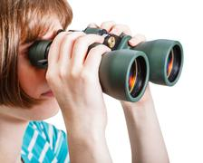 girl watching through field glasses isolated - stock photo