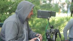 Focuspuller works with remote focus follow.(film production) outdoors, day Stock Footage