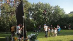 Filming scenes promotional video with the help of a crane.(film production) - stock footage
