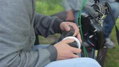 Focuspuller working on the set of the film.(film production) outdoors, day Stock Footage
