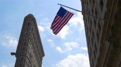 summer day light new york city flat iron bulding american flag waving 4k usa - stock footage