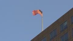 summer sunset light american flag waving on building top 4k usa - stock footage