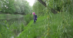 Left mid-distance view Child Girl walking on The Lakeside Stock Footage