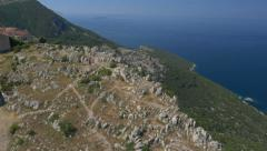Aerial - Person reaching the viewpoint at the edge of a cliff Stock Footage