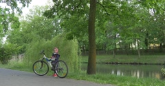 Mid-distance view Child Girl on The lakeside Stock Footage