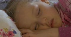 Child Girl Sleeps in The Day on a pillow Stock Footage