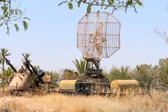 TCM-20 anti-aircraft gun and military radar Stock Photos