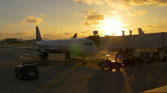 summer sunrise sky miami airport plain arrive 4k florida usa - stock footage