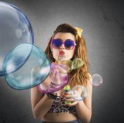 Blowing colored bubbles - stock photo