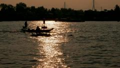 Can Tho - May 2015: Mekong delta in golden sunrise light with boat silhouette. Stock Footage