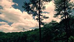 Da Lat - May 2015: Cable car above pine forest. Retro look. 4K speed up. Stock Footage