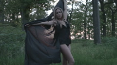 sexy woman wearing lingerie in the nature during sunset - stock footage