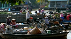 Mekong Delta - May 2015: Floating market with vendors on boats. 4K speed up. Stock Footage