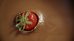 Strawberries Falling into Melted Chocolate - stock footage