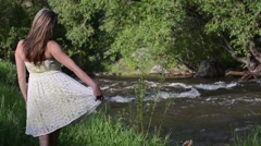 Woman enjoying a mountain stream Stock Footage