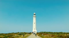 Tourists Walking Towards Cape Leeuwin Lighthouse in Western Australia Stock Footage