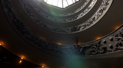 Vatican museums rome staircase tilt low view light rays Stock Footage