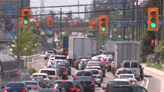 Traffic jam and gridlock on severe hot day with heat waves rising from pavement Stock Footage