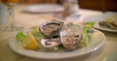 Stock Video Footage of Taking shots of oysters with smart phone