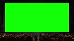 People in the auditorium with chroma key screen Stock Footage