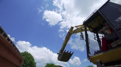Bucket of a large backhoe poured soil into a truck super slow motion Stock Footage