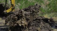 Stock Video Footage of metal bucket of an excavating backhoe carries mud spectacular slow motion