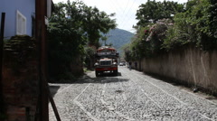 Stock Video Footage of Antigua Guatemala 56 - Passing Chicken Bus