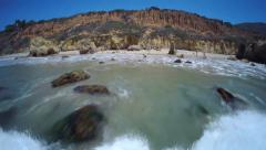 Low aerial shot of El Matador beach in Malibu California - stock footage