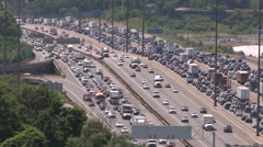 Traffic jam and bumper to bumper commuter gridlock on the 401 in Toronto Stock Footage