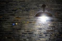 Old interior room with brick wall and three light spots - stock illustration