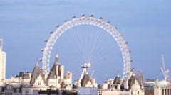 Famous London Eye attraction - aerial view from a rooftop - stock footage