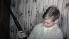 (8mm Vintage) 1965 Kid Gets BB Gun For Christmas. Don't Shoot Your Eye Out Stock Footage