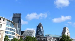 Clouds floating over the City of London with a Gherkin building (30 St Mary Axe) - stock footage