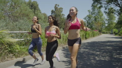 Happy Women running at the park Stock Footage