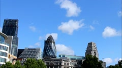 Clouds floating over the City of London with a Gherkin building (30 St Mary Axe) Stock Footage