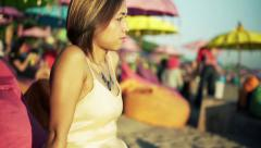 Young beautiful pensive woman sitting alone on the cafe by the beach  HD Stock Footage