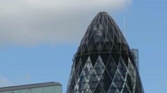 View of Gherkin building (30 St Mary Axe) at sunset in London Stock Footage