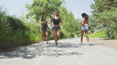 Girlfriends playing childhood games at the park Stock Footage