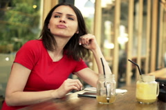 Impatient, young woman looking around and waiting for someone in cafe  NTSC - stock footage