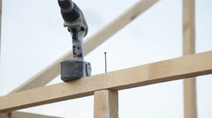 Tightening the screw in the construction beams Stock Footage