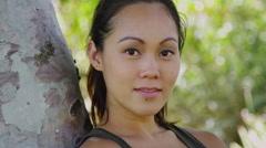Beautiful Asian woman smiling at camera - stock footage