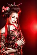Submissive geisha. - stock photo
