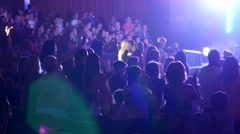 Crowds, audience applauds, cheerfully clapping, concert  Stock Footage