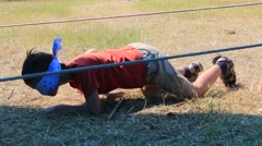 Boy crawling, sneaking under the ropes. Let. Stock Footage