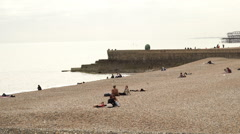 People relaxing at Brighton Beach Stock Footage